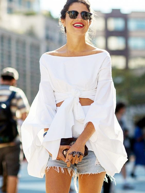 White off the shoulder dramatic top with knots and cut outs + denim cut off shorts: