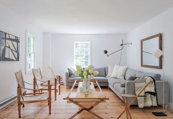 Airy minimal modern country living room decor with sling chairs and sectional. Simple Serene Cottage Home Decor Ideas