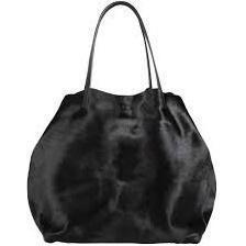 Eva Mendes wearing Ch Carolina Herrera Matryoshka Bag in Black.