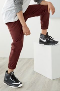 brown jogger pants for boys and Nike high-top sneakers