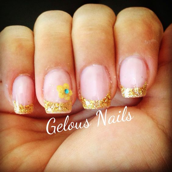Gold glitter tip gel nails, flower with a turquoise gem for accent nail.