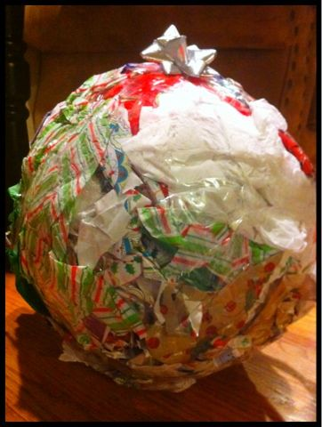 Fun game for holiday parties! make a big ball with lots of layers of tape and old wrapping paper filled with gifts, start with the youngest and the person to the right has the dice, they start dislodging gifts and candy until doubles are rolled and then they pass it on.  Use gloves to make it harder.