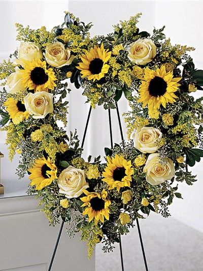 All yellow funeral heart with sunflowers and roses