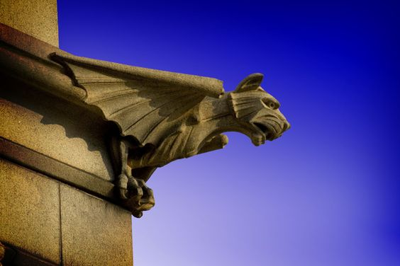 Sentinel A gargoyle located in the Oakland Cemetery near downtown Atlanta, Georgia. Available for purchase as a print at purephoto.com