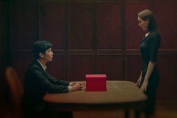 Lee Min Ki And Lee Yoo Young Mull Over A Red Box Of Secrets In Main Poster For New Thriller Drama