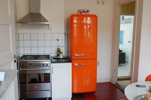 small kitchen with an orange smeg refrigerator gorgeous