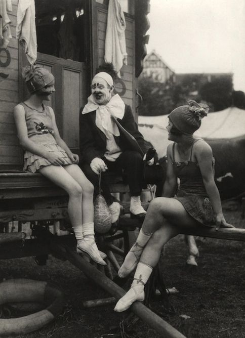 E.O. Hoppé  Thora and Nellie joking with clown, Travelling Circus, c.1918