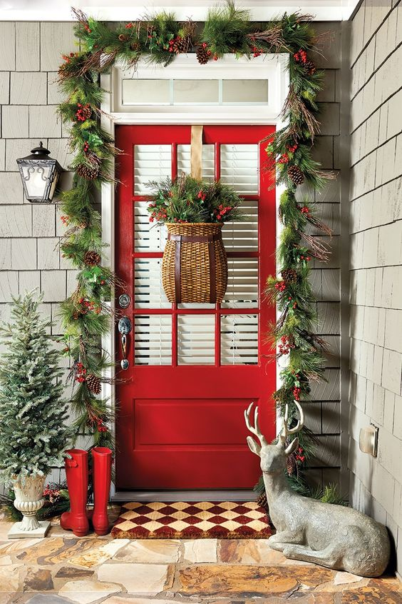 Beautiful outdoor Christmas decor with gorgeous red door and cedar shake siding