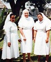 Sisters in South Africa's   white veil, white robe girt bar