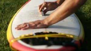 Decorate a surf party invitation to look like a surfboard.