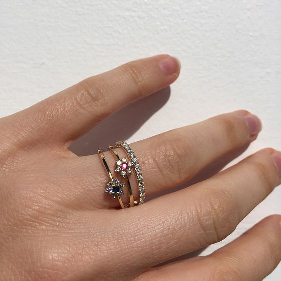 """""""Mornings with the #babyanything Lux floral cluster rings in Ruby, Sapphire and Diamond and the Starlight diamond eternity ring! Amazing ✨…"""""""