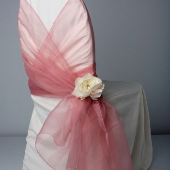 Chair wrap. I LIKE this idea! It's very different. And if the sashes were all done on the aisle chairs, then it would create nice aisle decorations with the flowers...