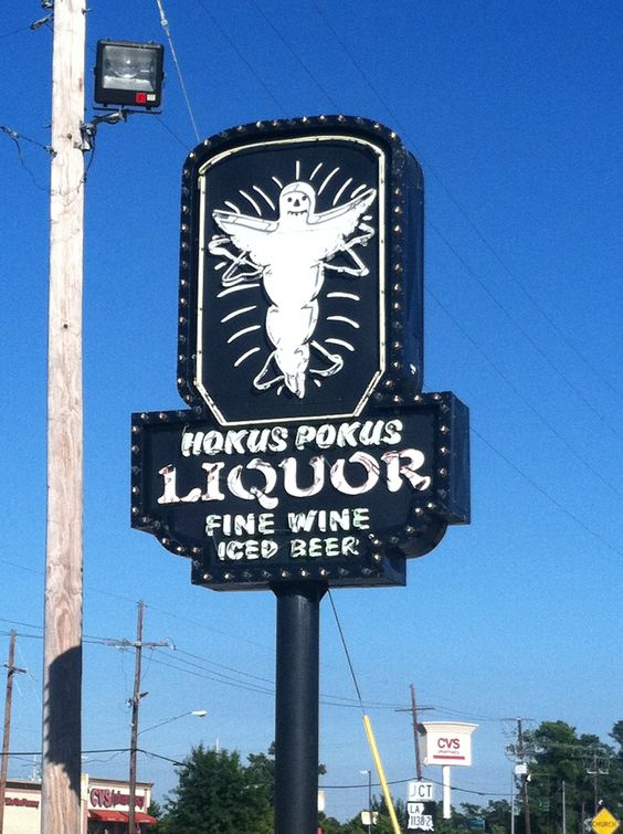 Hocus Pocus Liquor is my favorite local sign.  It's neon ghost moves at night!
