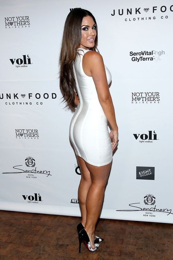 hotminiskirts:  Beautiful Carissa Rosario in a skin tight little white dress.  Check out our new website: Ooh La La Club! Battle of Legs, Rate Some Legs and more!