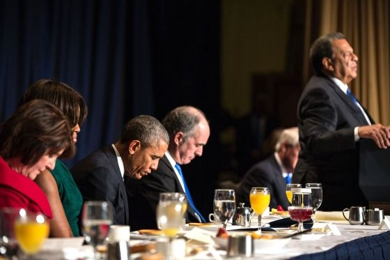 "The President and First Lady Michelle Obama join former Atlanta Mayor Andrew Young in the closing prayer during the National Prayer Breakfast  Our Christian President praying. So much for ""he's a muslim""."
