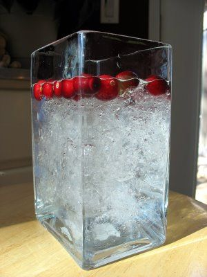 Plastic wrap and water to make a faux icy centerpiece!  GREAT IDEA - and no glass sweating