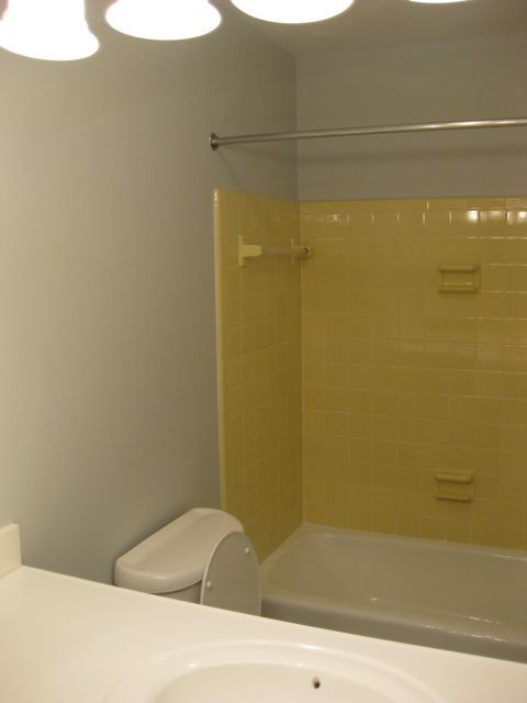 Superior Tile · Bathroom With Yellow Tiles