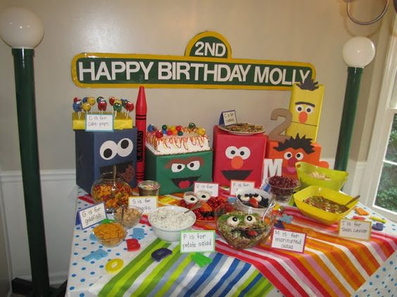 Diaper boxes wrapped in butcher paper and decorated to look like Sesame Street characters.  Veggie and Fruit trays made to look like Elmo and Grover.