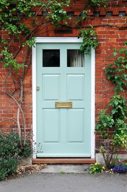10 Unexpected Color Schemes For Home Exteriors Brick Exterior House Painted Front Doors Orange Brick Houses