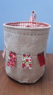 love the clothesline on this basket.  Would be a cute scrap basket for sewing and crafting.