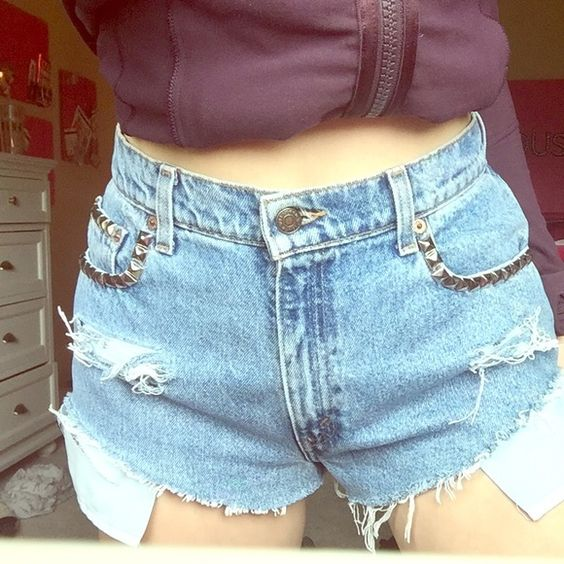 Levi's Studded High Waisted Shorts Bought from a consignment shop, put under urban for exposure. In great condition! Urban Outfitters Shorts Jean Shorts