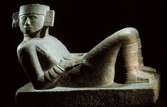 Reclining figure with plate on abdomen,	 Maya	 - Early Post-Classic (900-1250 A.D.), Chich'en Itzá, State of Yucatán.	 Sandstone	 - National Museum of Anthropology, Mexico. Photo © Jorge Pérez de Lara