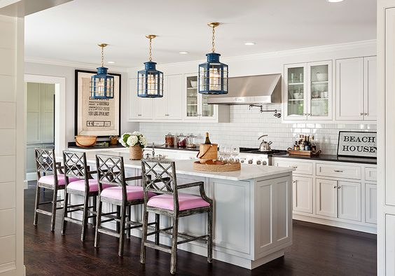 Gray island stools with pink seat cushions
