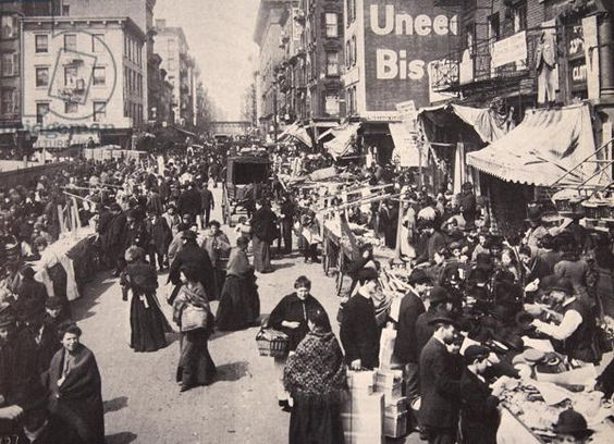 On New York's East Side Immigrants collected in numbers at Bowery, buying and selling, 1900s