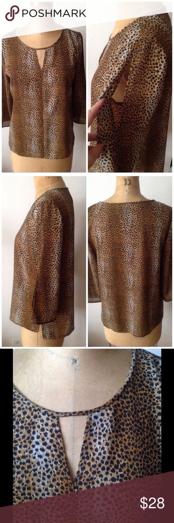 LEOPARD PRINTED CHIFFON TOP Beautiful chiffon top, Tiny leopard printing. Sexy v opening at the center neckline. Hem slightly hi/lol design. 3/4 sleeves. Cold shoulder design. Super soft fabric. Great for work or a night out. Great top! Tops