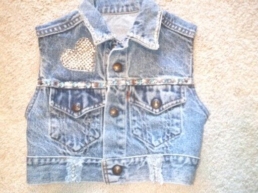 Dazzled vest, I got the jacket at good will, it had the heart on it, made it a vest then cut jewels off of an old prom dress and made it for my granddaughter