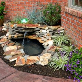 DIY tutorial on how to build a backyard pond and landscape water feature for thousands of dollars less!