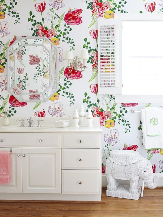 Feminine wallpaper and white wicker hang out in this lovely bathroom #hgtvmagazine http://www.hgtv.com/decorating-basics/tropical-style-in-the-suburbs/pictures/page-7.html?soc=pinterest