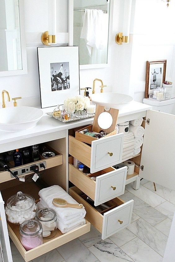 Looks like some good ways to get more storage in bathrooms.  Love the outlet solution!