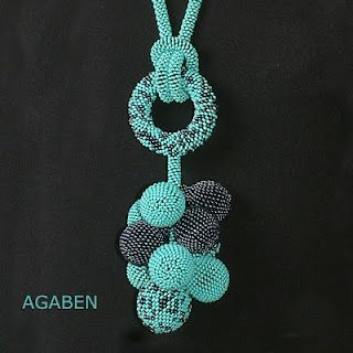 I like the use of seed beads and the colors in this piece. I don't know if I would ever make it or wear it.