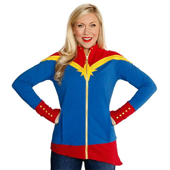 Captain Marvel's uniform has now been turned into a full-zip jacket by our friends at Her Universe. This jacket features gold embroidery thread and a gold zipper, with all colors cut-and-sewn instead of printed on.
