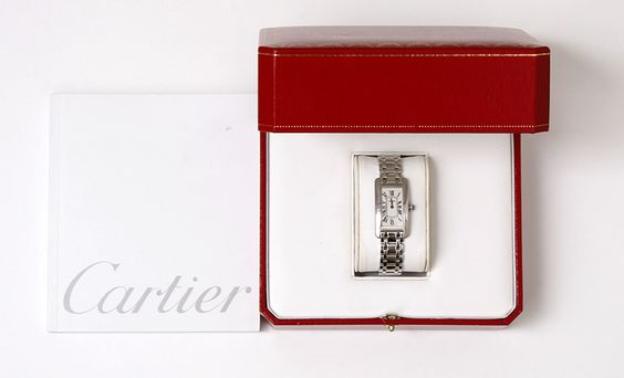 Cartier Lady's White Gold Tank Americaine Wristwatch | From a unique collection of vintage wrist watches at http://www.1stdibs.com/jewelry/watches/wrist-watches/