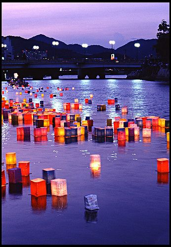 Hiroshima, Japan - Lanterns at Twilight. On the anniversary of the bombing of Hiroshima (August 6th), lanterns are sent floating along the Motoyasu-gawa River.:
