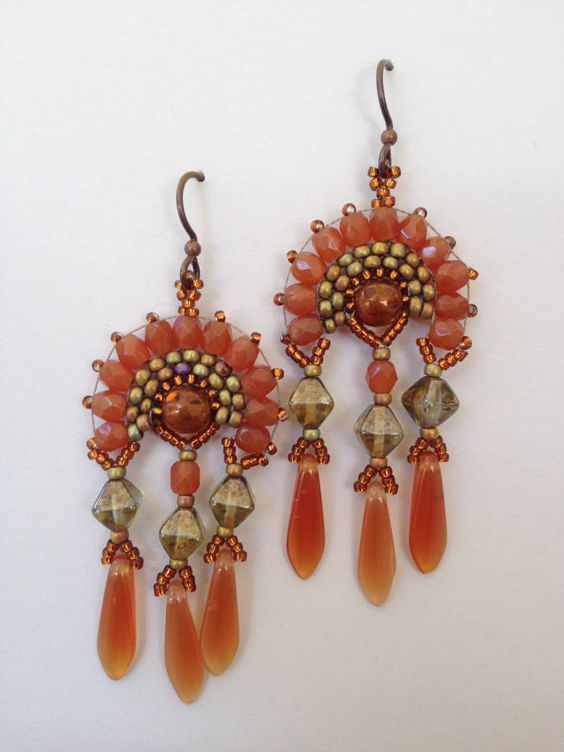 These large fan shaped earrings in pale carnelian orange glass with olive green accents are very beautiful and dramatic yet comfortable and: