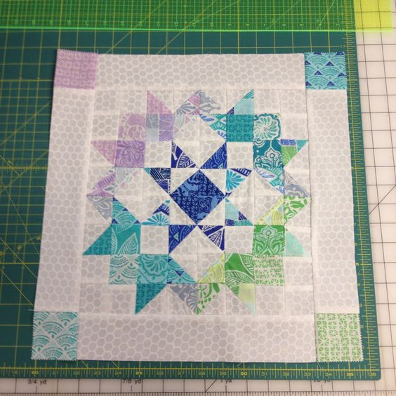 Yet another mini quilt top! This line of fabric is from Kate Spain's Horizon line, and the pattern is from Moda's Love Quilt. I'm making a bigger version of this too!!