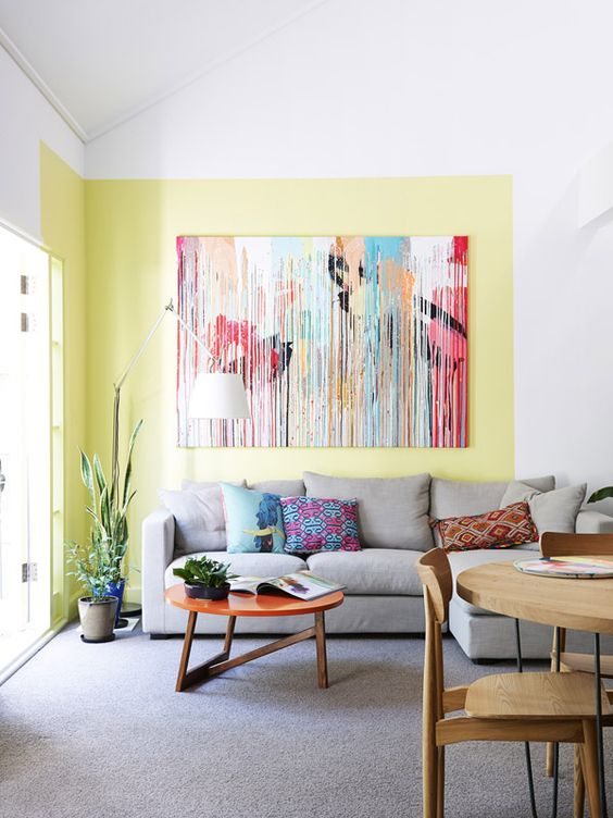 The East Melbourne apartment of artists Rowena Martinich and her husband Geoffrey Carran. How clever is that swatch of yellow paint?