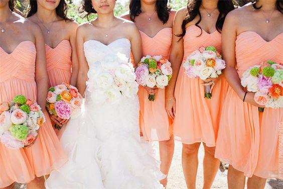Sweetheart bridesmaids dresses in peach.
