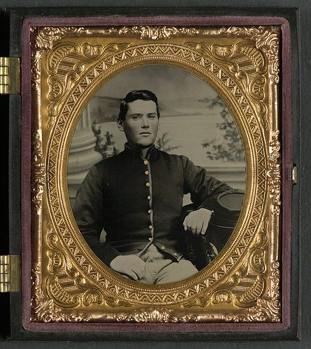 [Private Jonathan Colgrove of Co. F, 57th Pennsylvania Infantry Regiment, in uniform in front of painted backdrop showing column base and landscape] (LOC) | Flickr - Photo Sharing!