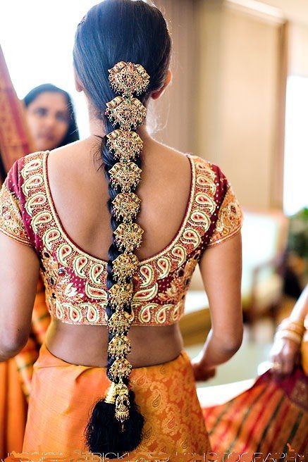 I really love this! I searched for the name of this hair jewelry. It is called a Choti.