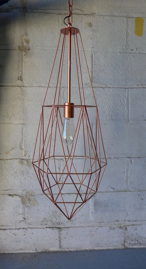 In collaboration with Brooklyn Lighting Company, we are pleased to offer this handmade Mid century modern large cage pendant lamp / chandelier. Copper