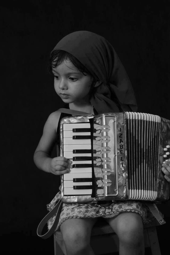 ♫♪ Music ♪♫ Black and White girl portrait with accordion:
