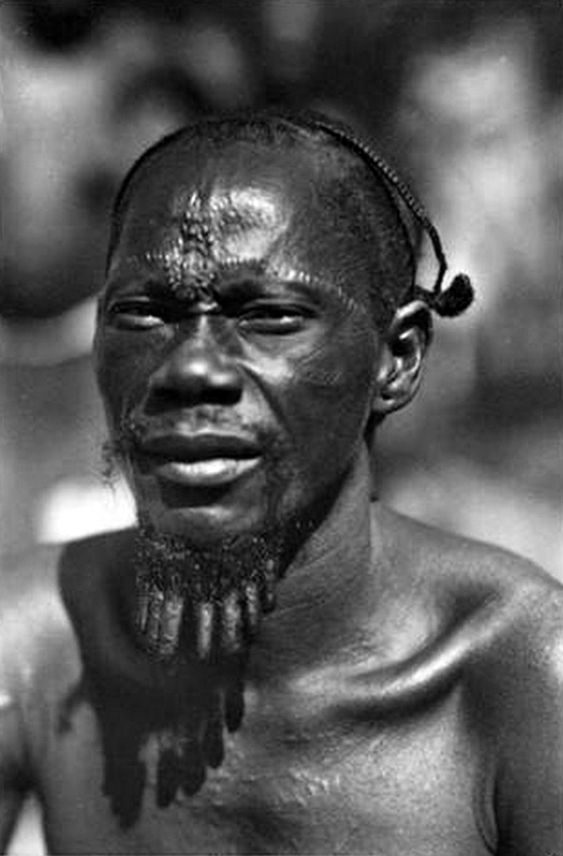 Africa | Man of the Gombe in Province de l'Equateur (now Equator Province, Democratic Republic of the Congo). | © Casimir Zagourski African postcards, 1924-1941 (inclusive). Manuscripts & Archives, Yale University
