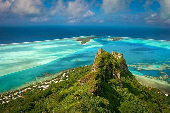 @tahititourisme -  Mountain or ocean green or blue... We just can't get enough of Maupiti! Credit: Piotr Gatlik