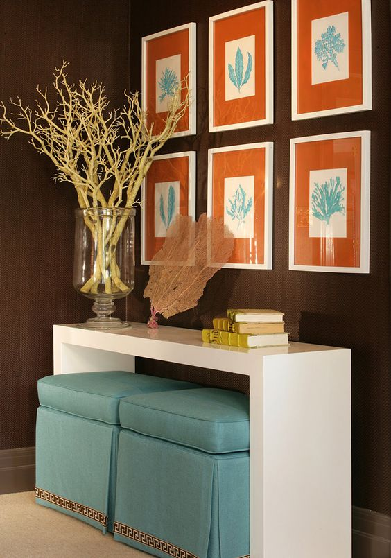 Love the orange  and the Table with tucked in ottomans.... complementary blue and orange - Fieldstone Hill Design: