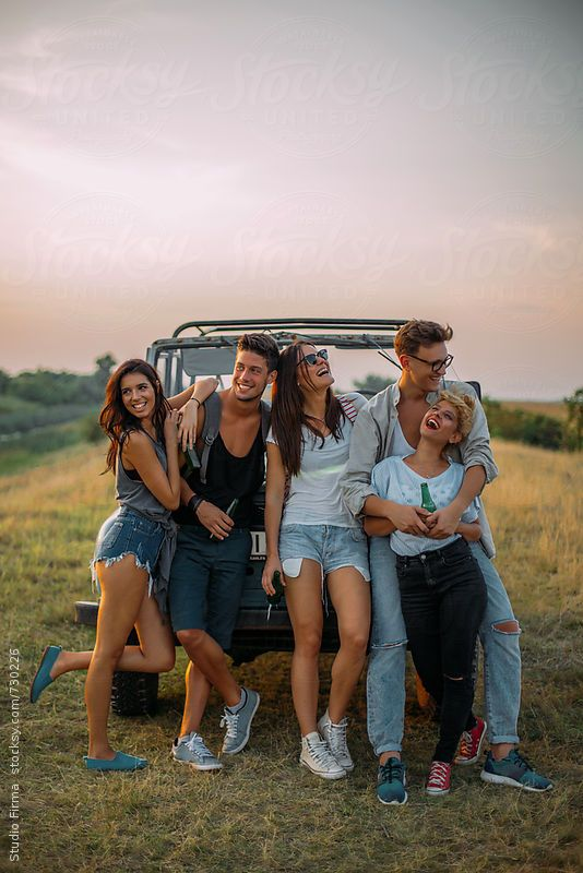 Group of friends laughing and hanging around the truck