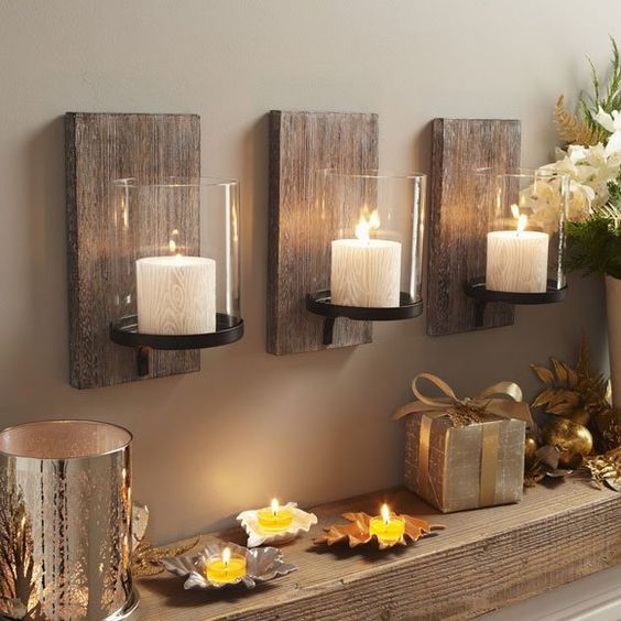Candles mounted on barn wood.